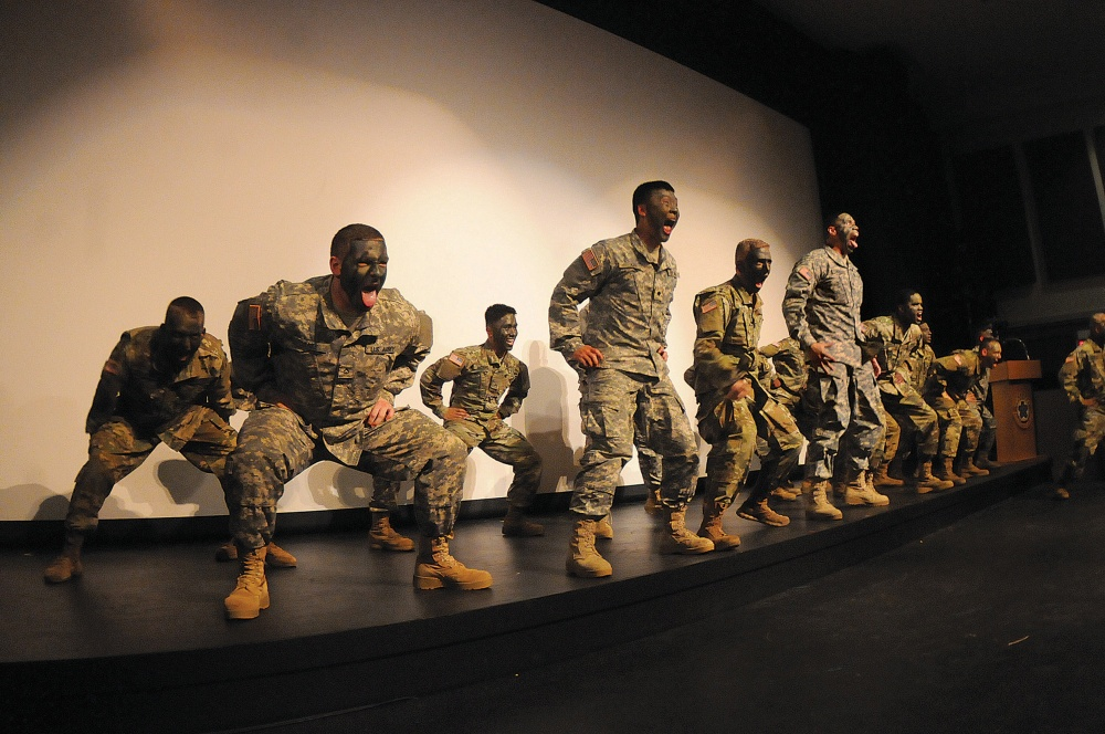 Soldiers assigned to the U.S. Army's 832nd Ordnance Battalion perform a  routine featuring the Polynesian war cry during the Asian American Pacific  Islander ...