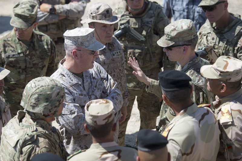 Marine Corps Gen. Joe Dunford, center left, chairman of the Joint Chiefs of Staff, speaks with Army Lt. Gen. Sean MacFarland, commander of Combined Joint Task Force Operation Inherent Resolve