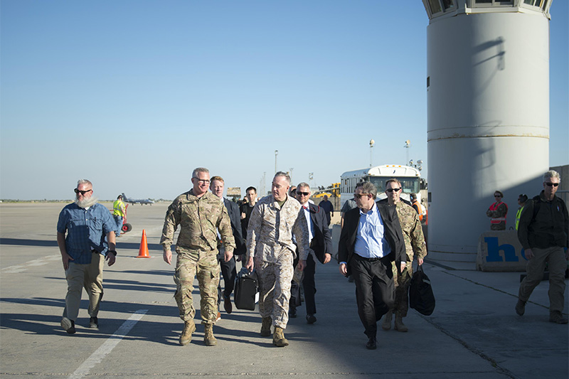 Marine Corps Gen. Joe Dunford, chairman of the Joint Chiefs of Staff, center, walking with U.S. Ambassador to Iraq, Stuart E. Jones, right, and Army Gen. Paul J. LaCamera, chief, Office of Security Cooperation - Iraq.