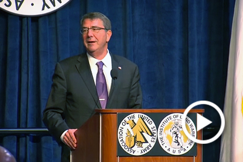 Carter standing behind podium at AUSA Luncheon