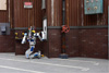Photo of Team Kaist's robot DRC-Hubo using a tool to cut a hole in a wall during the DARPA Robotics Challenge Finals.