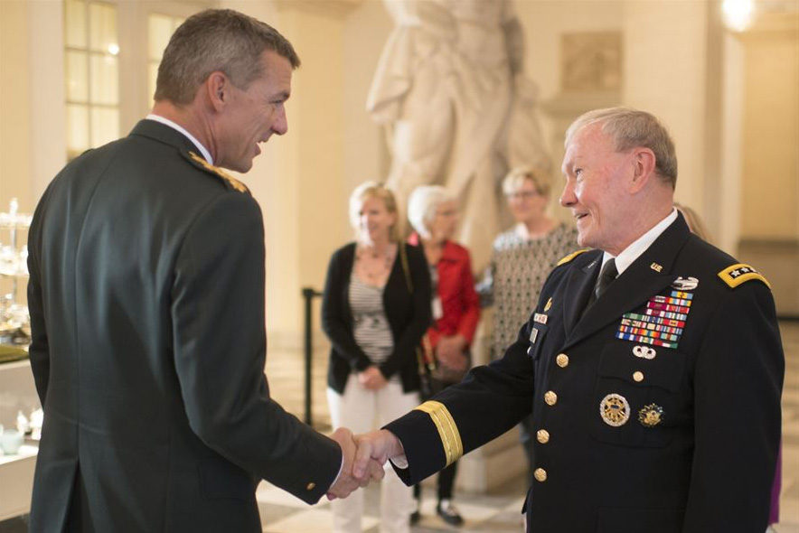 Danish Chief of Defense Gen. Peter Bartram and U.S. Army Gen. Martin E. Dempsey, chairman of the Joint Chiefs of Staff, shake hands as they conclude their visit in Copenhagen, Denmark, Aug. 18, 2015.
