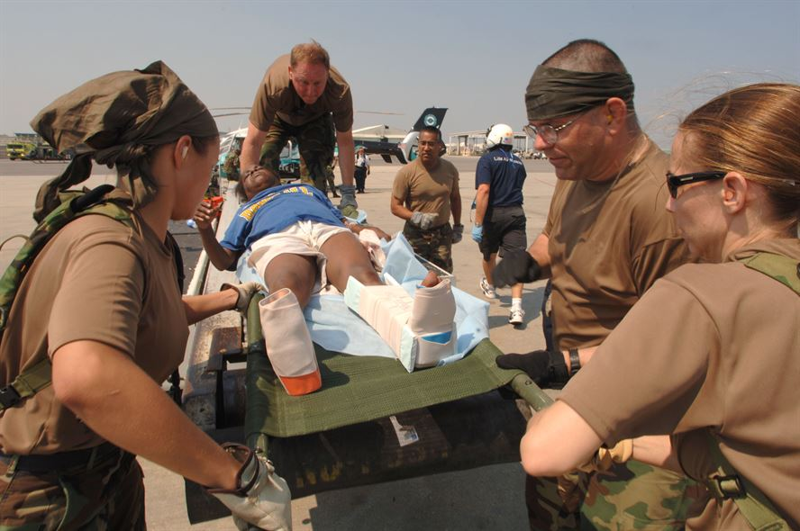 Crews carry Hurricane Katrina victims