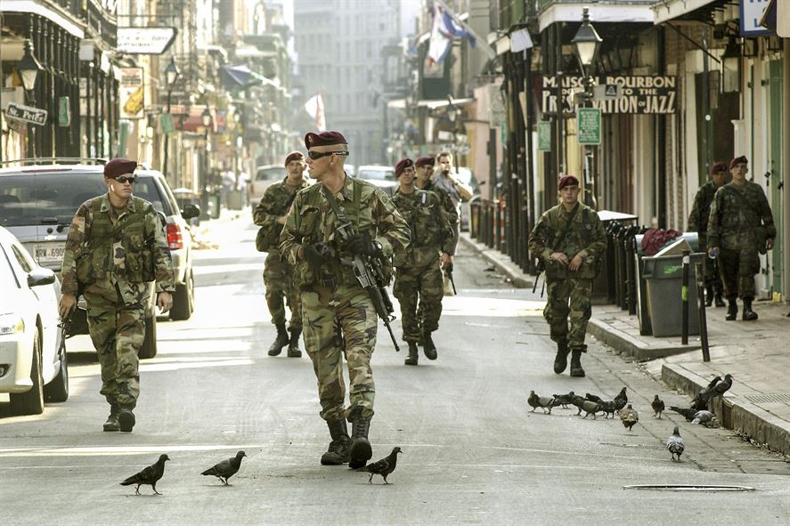 Soldiers patrol nearly deserted streets in the French Quarter i