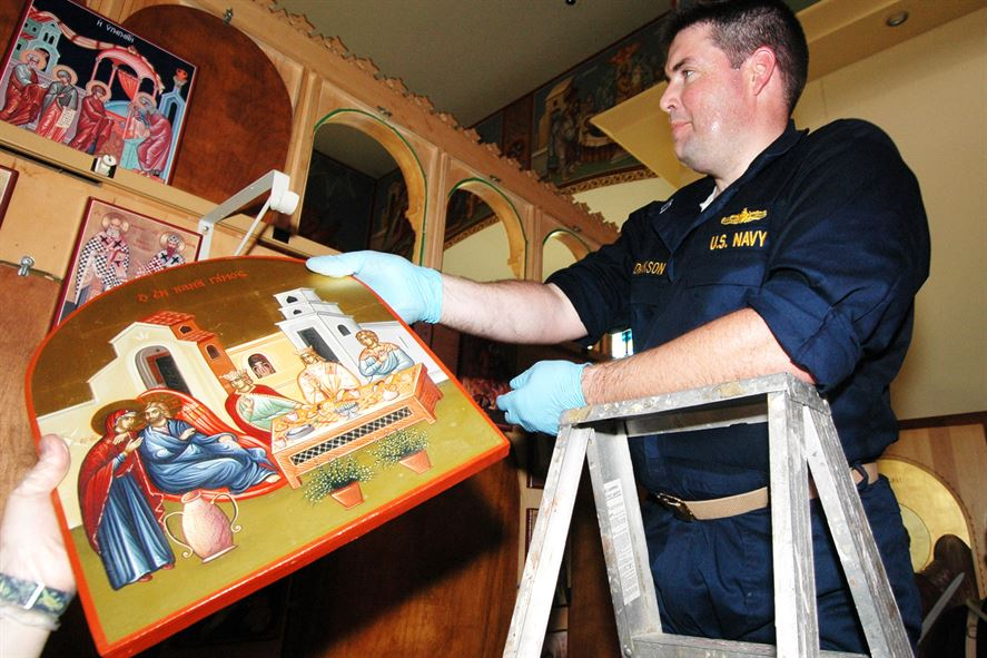 Navy Chaplain Lt. Michael Hendrickson helps clean up the Greek Orthodox Church of New Orleans