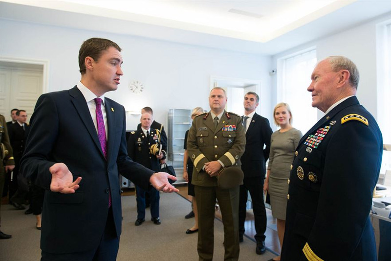 Estonian Prime Minister, Taavi Roivas, left, speaking with U.S. Army Gen. Martin E. Dempsey, chairman of the Joint Chiefs of Staff.