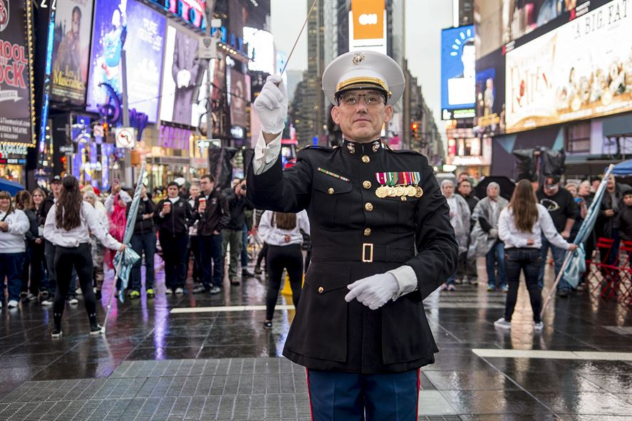 Marine Corps Chief Warrant Officer 4 Robert Sabo, the band director of Marine Corps Base Quantico, leads musicians in New York City