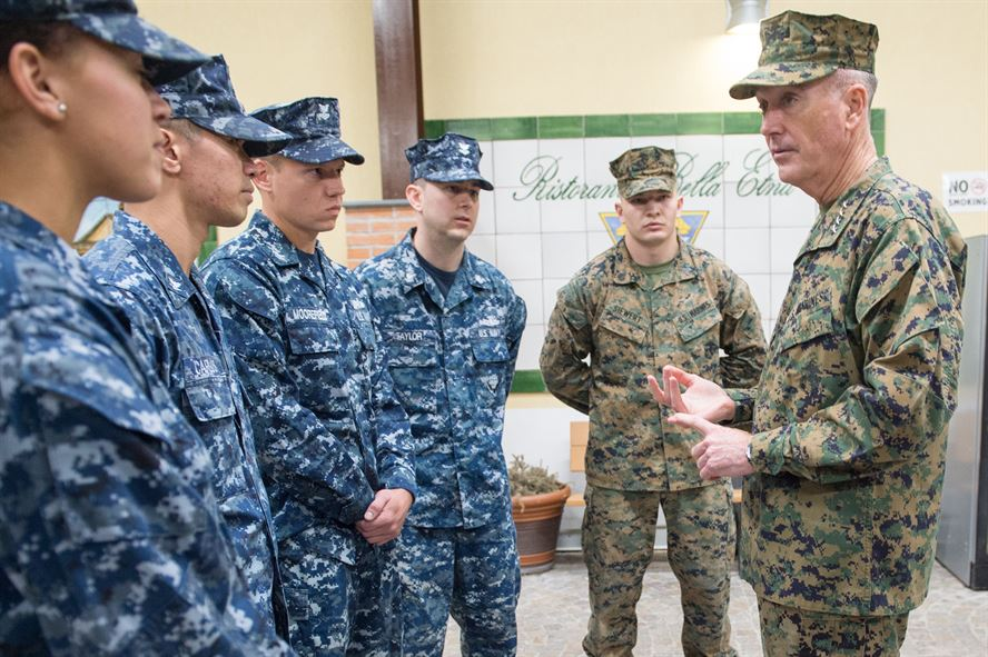 U.S. Marine Corps Gen. Joseph F. Dunford Jr., chairman of the Joint Chiefs of Staff, talks with U.S. service members.