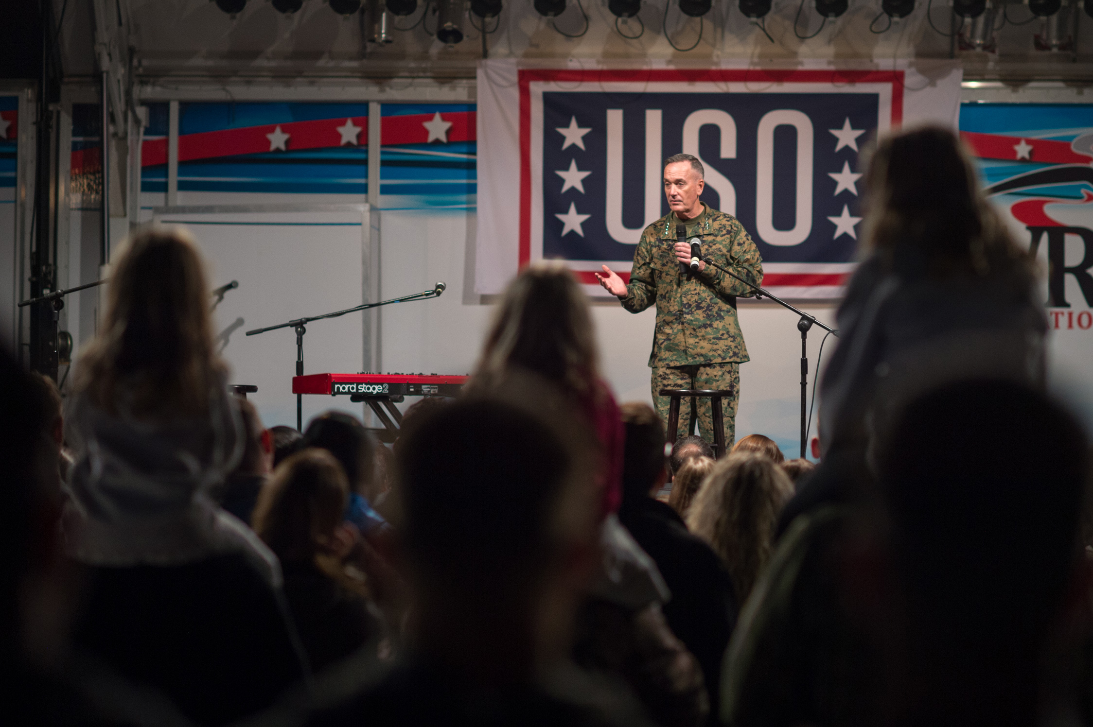 U.S. Marine Corps Gen. Joseph F. Dunford Jr., chairman of the Joint Chiefs of Staff, talks with U.S. service members and their families