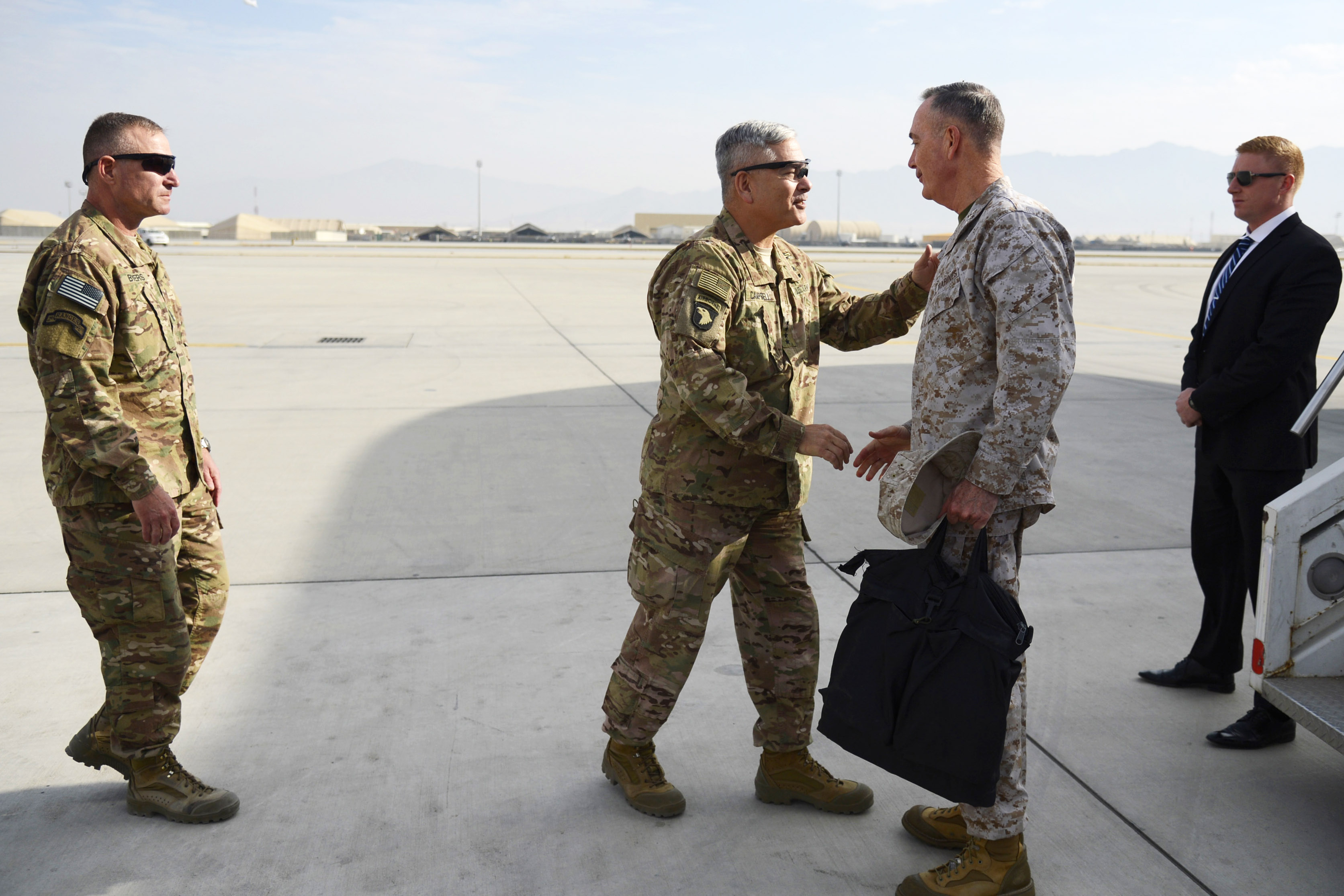 U.S. Army Gen. John Campbell shaking hands with U.S. Marine Corps Gen. Joseph F. Dunford Jr., chairman of the Joint Chiefs of Staff, on the tarmac
