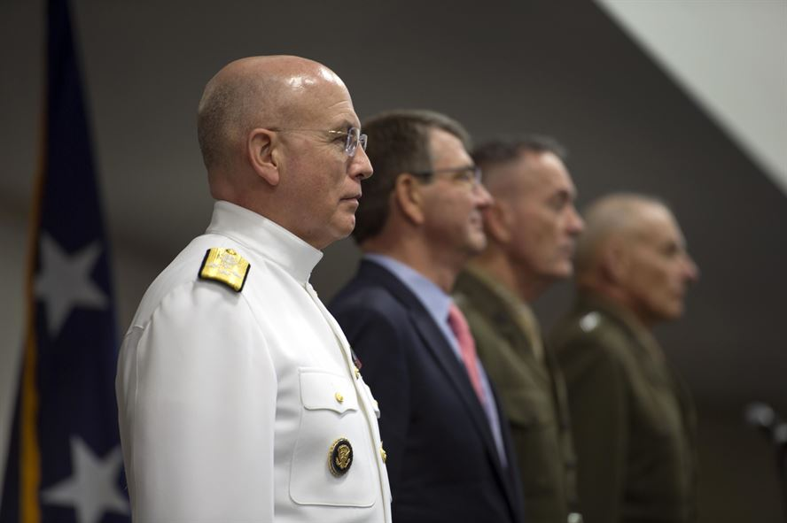 Navy Admiral Kurt W. Tidd, Defense Secretary Ash Carter, Marine Corps Gen. Joseph F. Dunford Jr., chairman of the Joint Chiefs of Staff, and Marine Corps General John F. Kelly stand at front with the official party for the change command ceremony of U.S. Southern Command