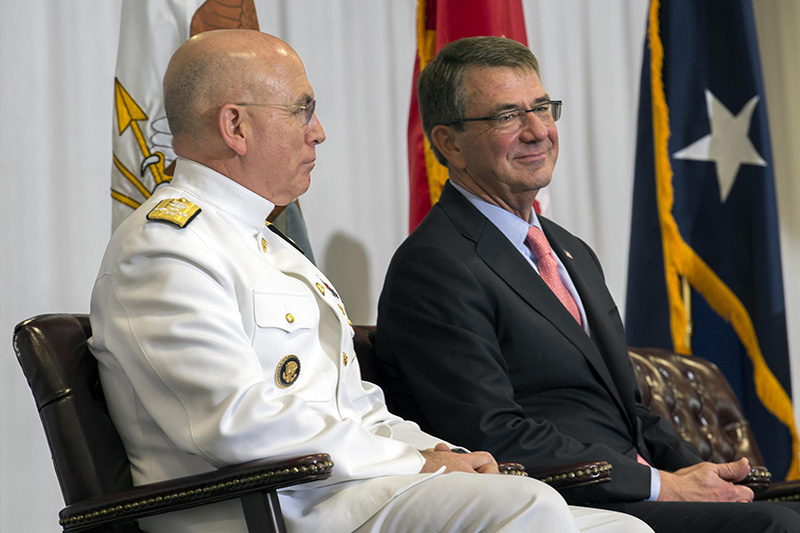 Defense Secretary Ash Carter and U.S. Navy Adm. Kurt W. Tidd smiling together