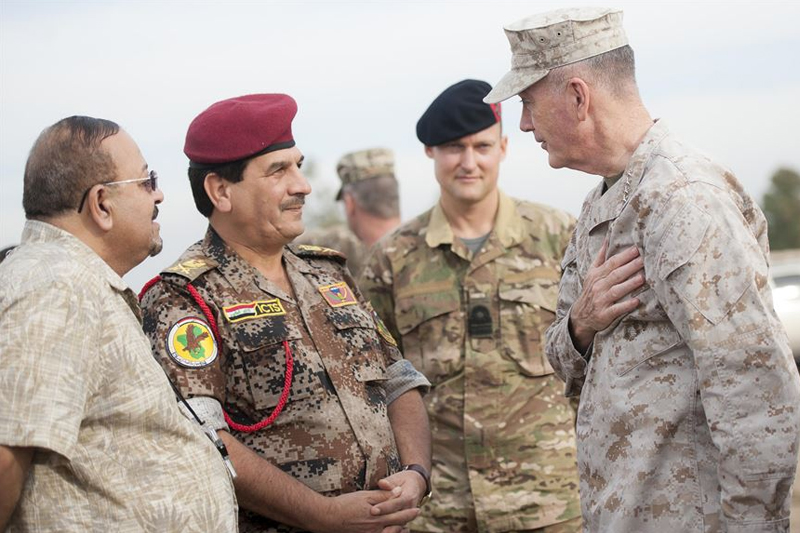 Photo of U.S. Marine Corps Gen. Joseph F. Dunford Jr., right, chairman of the Joint Chiefs of Staff, meeting with a member of the Iraqi special operation forces at Area VI training site in Baghdad.