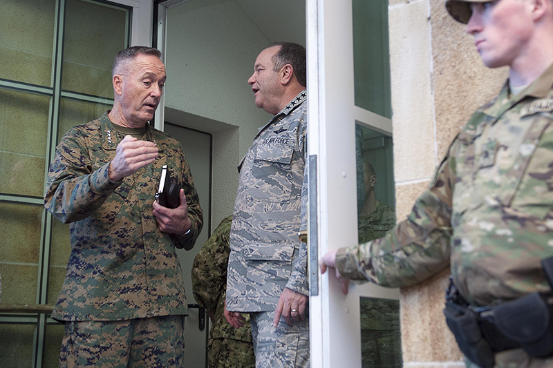 Photo of U.S. Marine Corps Gen. Joseph F. Dunford Jr., left, chairman of the Joint Chiefs of Staff, speaking with U.S. Air Force Gen. Philip M. Breedlove, commander, U.S. European Command, and Supreme Allied Commander Europe, at the Eucom headquarters in Stuttgart, Germany.