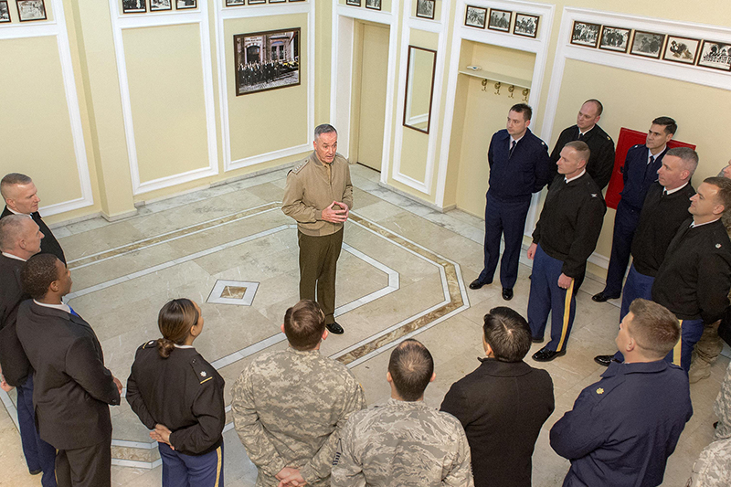 Photo of U.S. Marine Corps Gen. Joseph F. Dunford Jr., chairman of the Joint Chiefs of Staff, talking with service members assigned to the Office of Defense Cooperation in Ankara, Turkey.
