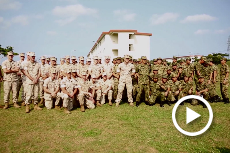 Screen grab of soldiers standing for a group photo.