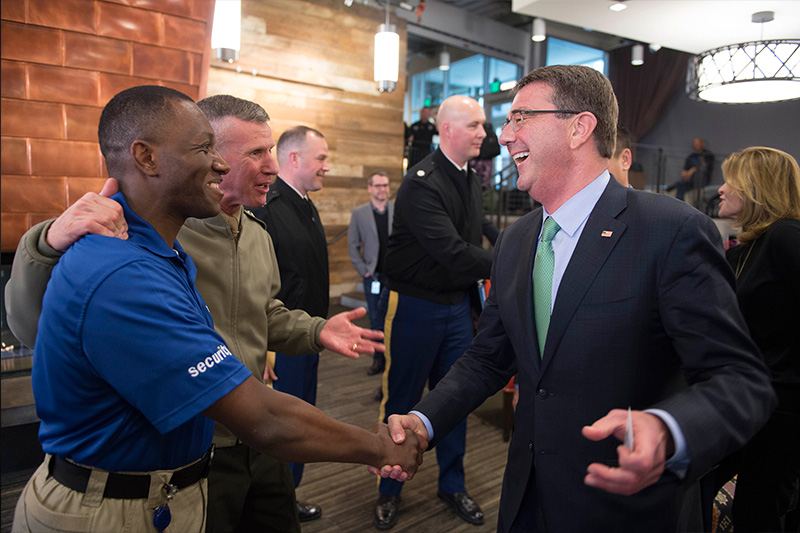 Defense Secretary Ash Carter meets a former Marine currently working for Amazon.com