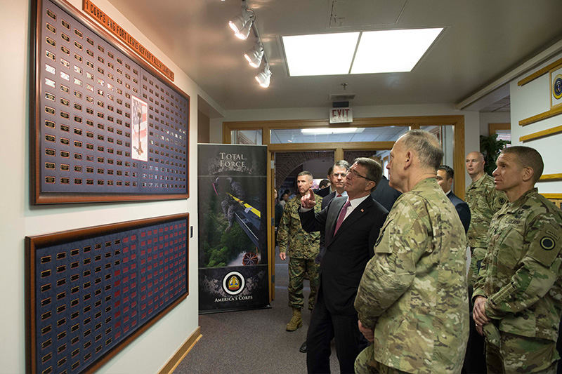 Defense Secretary Ash Carter stoping to read the wall acknowledging the fallen troops of I Corps.