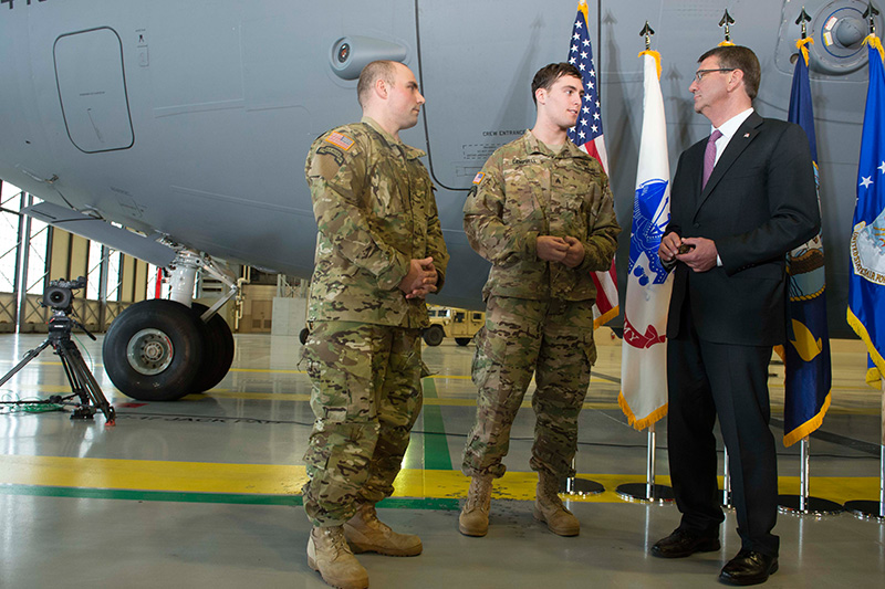 Defense Secretary Ash Carter meeting with Army Sgt. First Class Hastings, left, and Army Sgt. Campbell, both wounded in Afghanistan.