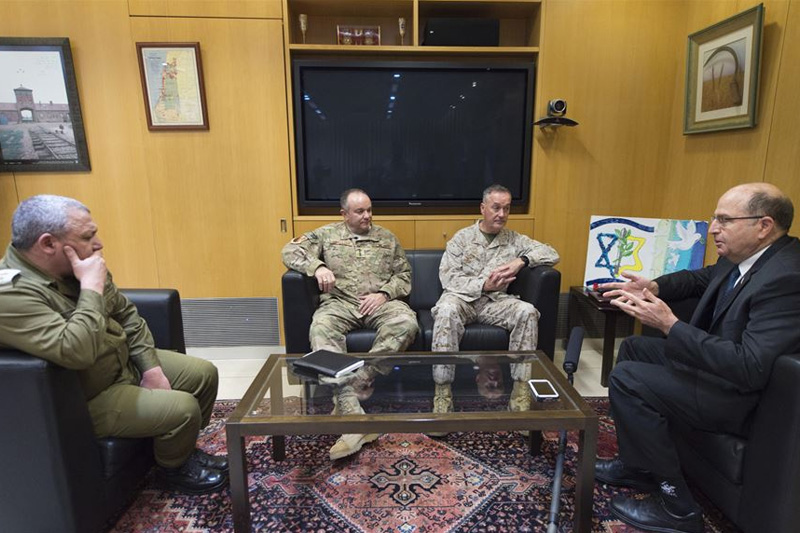 U.S. Marine Corps Gen. Joseph F. Dunford Jr., center right, chairman of the Joint Chiefs of Staff, meeting with, from left, Israeli Lt. Gen. Gadi Eizenkot, the commander in chief of the Israel Defense Forces; U.S. Air Force Gen. Philip M. Breedlove, NATO's supreme allied commander for Europe and commander of U.S. European Command; and Israeli Defense Minister Moshe Yaalon at the Ministry of Defense in Tel Aviv, Israel.