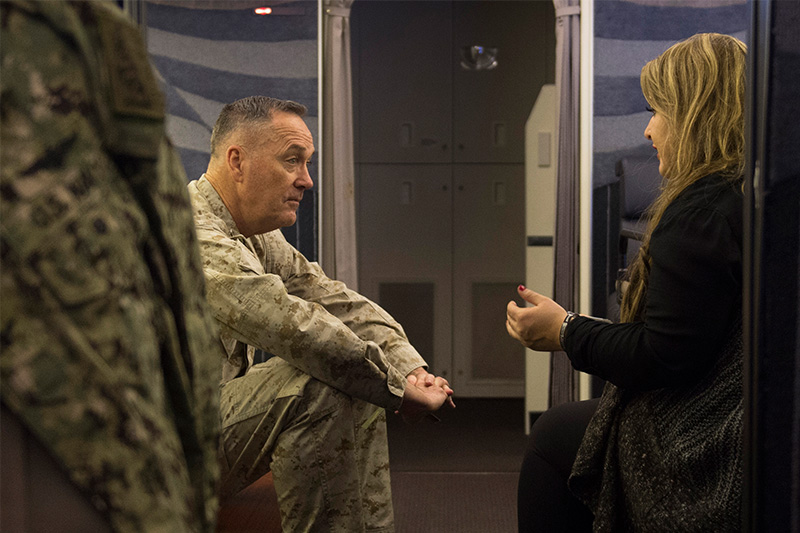 Marine Corps Gen. Joseph F. Dunford Jr., chairman of the Joint Chiefs of Staff, sitting and talking with Jane Horton.