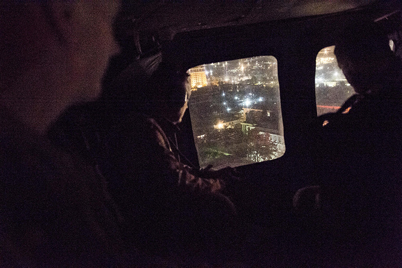 Marine Corps Gen. Joseph F. Dunford Jr., chairman of the Joint Chiefs of Staff looking out the window of a helicopter.
