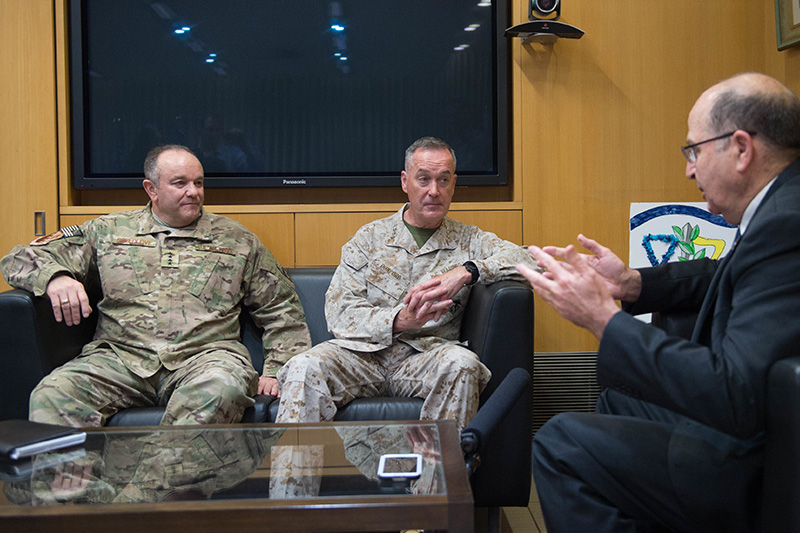 Marine Corps Gen. Joseph F. Dunford Jr., center, chairman of the Joint Chiefs of Staff, and Air Force Gen. Philip M. Breedlove, left, NATO's supreme allied commander for Europe and commander of U.S. European Command, sitting on a couch meeting with Israeli Defense Minister Moshe Yaalon.