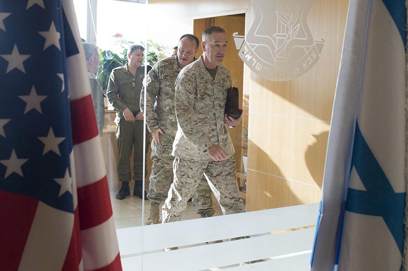 Marine Corps Gen. Joseph F. Dunford Jr., chairman of the Joint Chiefs of Staff walking through a door.