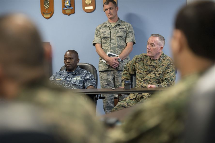 Marine Corps Gen. Joseph F. Dunford Jr., chairman of the Joint Chiefs of Staff, talks with liaison officers