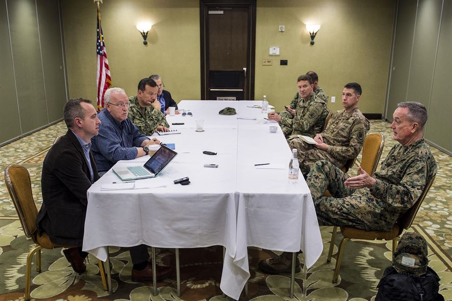 Marine Corps Gen. Joseph F. Dunford Jr., chairman of the Joint Chiefs of Staff, right, meets with reporters