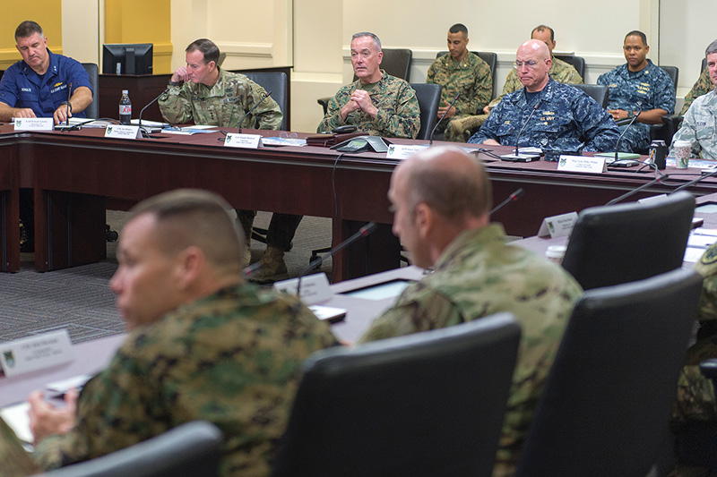 Marine Corps Gen. Joseph F. Dunford Jr., center back, chairman of the Joint Chiefs of Staff, meeting with Navy Adm. Kurt W. Tidd, commander, U.S. Southern Command, and other leaders at the command's headquarters.