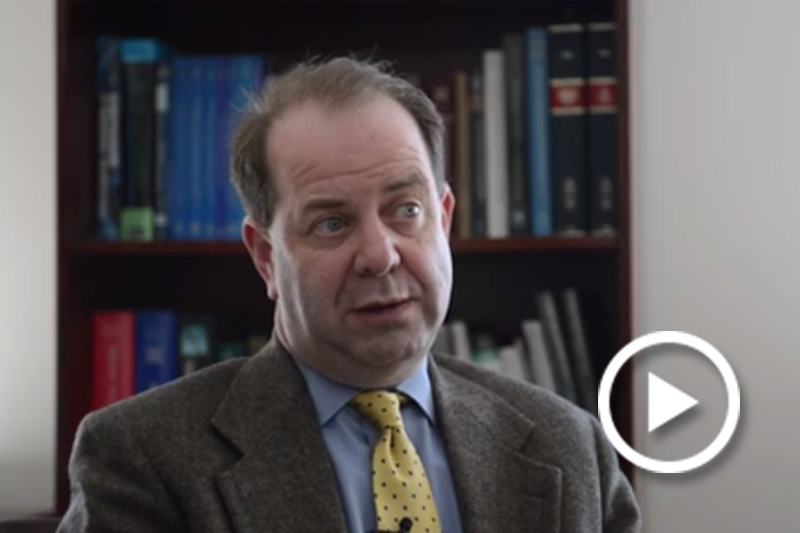 Screen grab of Dr. Louis French, Deputy Director, Clinical and Research Operations, NICoE, giving an interview.