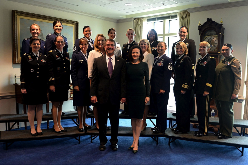 Secretary Carter posing with 17 female service members, many in uniform.