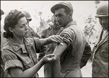 An army nurse Ernestine Koranda instructs Army medics on the proper method of giving an injection, Queensland, Australia, 1942.