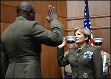 Brigadier General Angela Salinas restates her oath during her promotion ceremony August 2, 2006 aboard Marine Corps Base Quantico, Va.