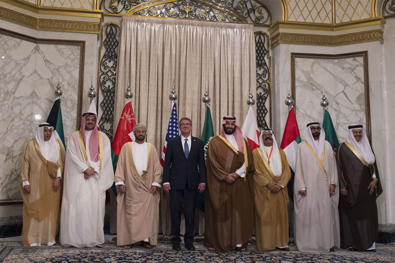 Defense Secretary Ash Carter posing for a photo with Gulf Cooperation Council defense ministers.