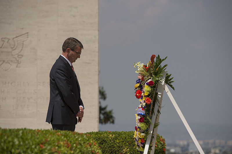 Defense Secretary Ash Carter pausing for a moment of silence after placing a wreath at the Manila American Cemetery.