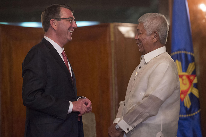 Defense Secretary Ash Carter sharing a light moment with Philippine Defense Secretary Voltaire Gazmin.
