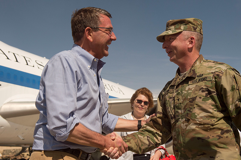 Defense Secretary Ash Carter shaking hands with U.S. Army Brig. Gen. Joe Rank, defense attache to the United Arab Emirates.