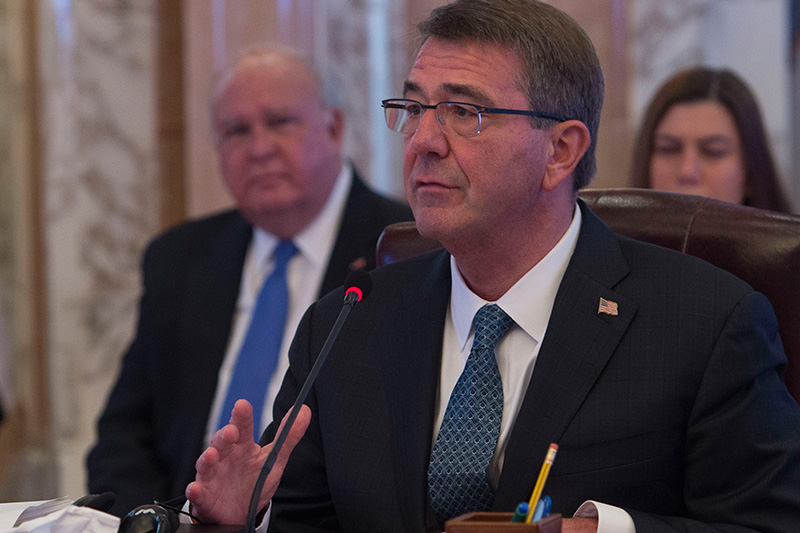 Defense Secretary Ash Carter delivers remarks into a microphone.