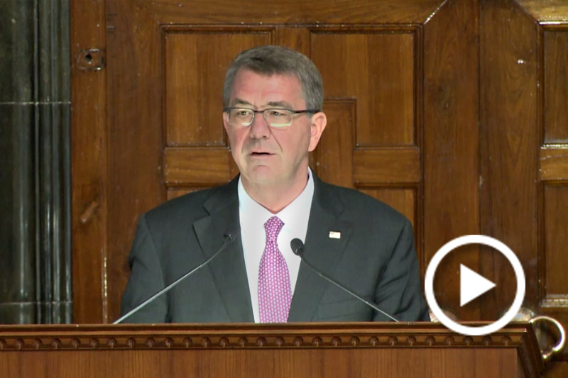 Screen grab of Defense Secretary Ash Carter speaking ayt a podium.