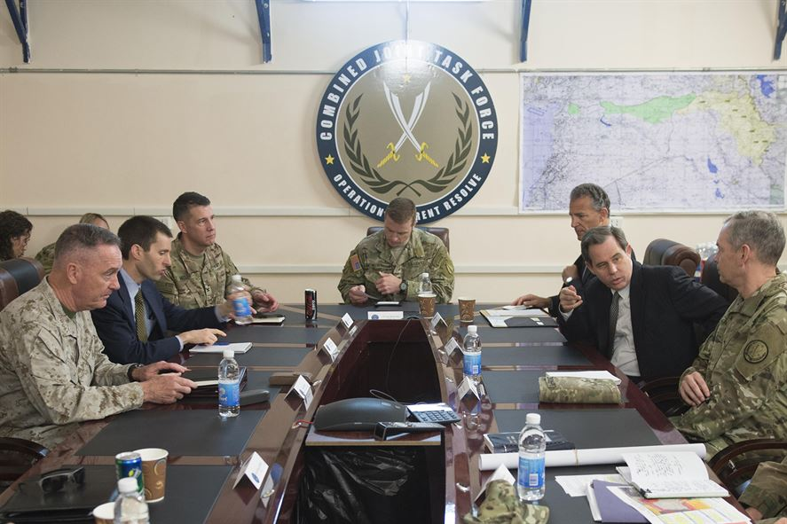 Marine Corps Gen. Joe Dunford, chairman of the Joint Chiefs of Staff, left, meets with U.S. Ambassador to Iraq, Stuart Jones, second from right, and Army Lt. Gen. Sean McFarland, commander, Combined Joint Task Force - Operation Inherent Resolve