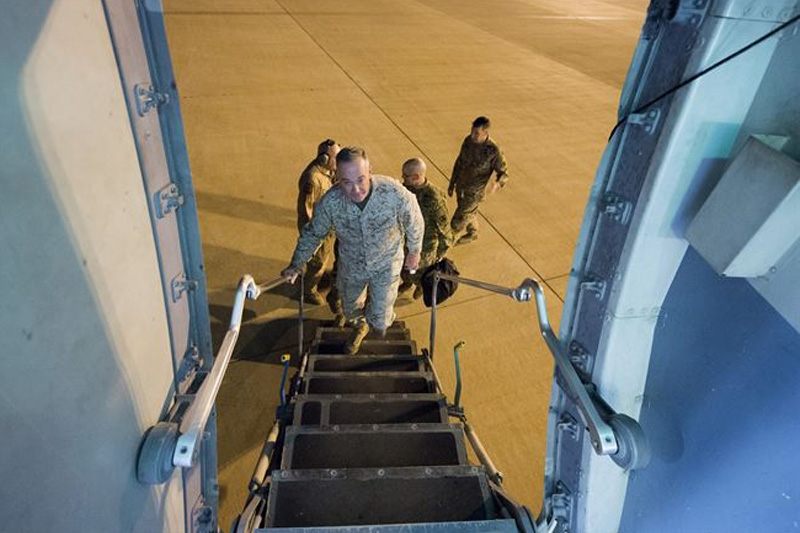 Marine Corps Gen. Joe Dunford, chairman of the Joint Chiefs of Staff boarding an aircraft