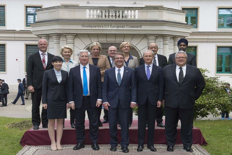 Defense Secretary Ash Carter takes a photograph with defense ministers