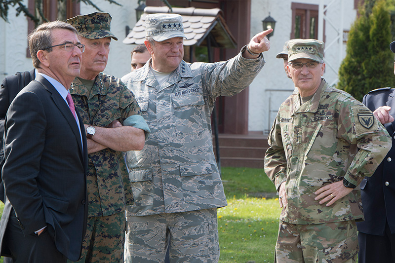 Defense Secretary Ash Carter, left, and Marine Corps Gen. Joe Dunford, second left, chairman of the the Joint Chiefs of Staff, talking with Air Force Gen. Phillip M. Breedlove, center.