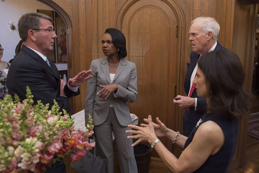 Defense Secretary Ash Carter speaks to former Secretary of State Condoleezza Rice and Stanford University President John Leroy Hennessy
