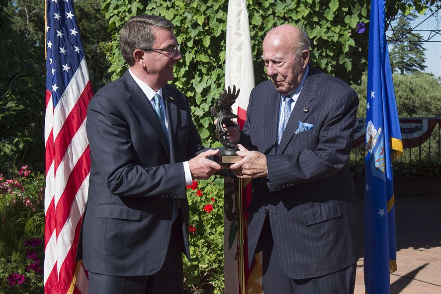 Defense Secretary Ash Carter presents former Secretary of State George P. Shultz with the Innovators in Defense, Enterprise, Academia and Science award