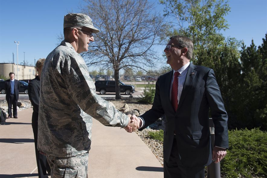Air Force Gen. John E. Hyten, commander of Air Force Space Command, greets Defense Secretary Ash Carter