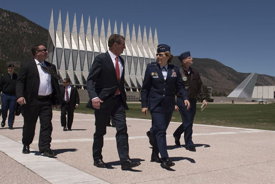 Defense Secretary Ash Carter walks with Air Force Lt. Gen. Michelle Johnson