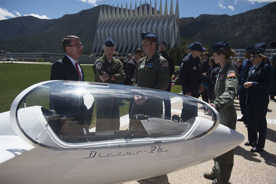 Defense Secretary Ash Carter listens to cadets talk about a training glider